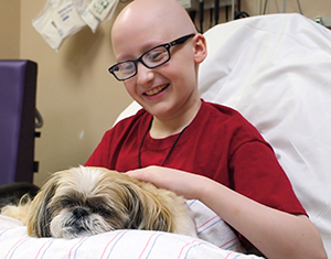 Photo of Kameron and Tiger the therapy dog